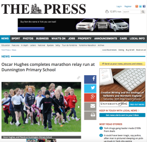 Oscar Hughes completes marathon relay run at Dunnington Primary School